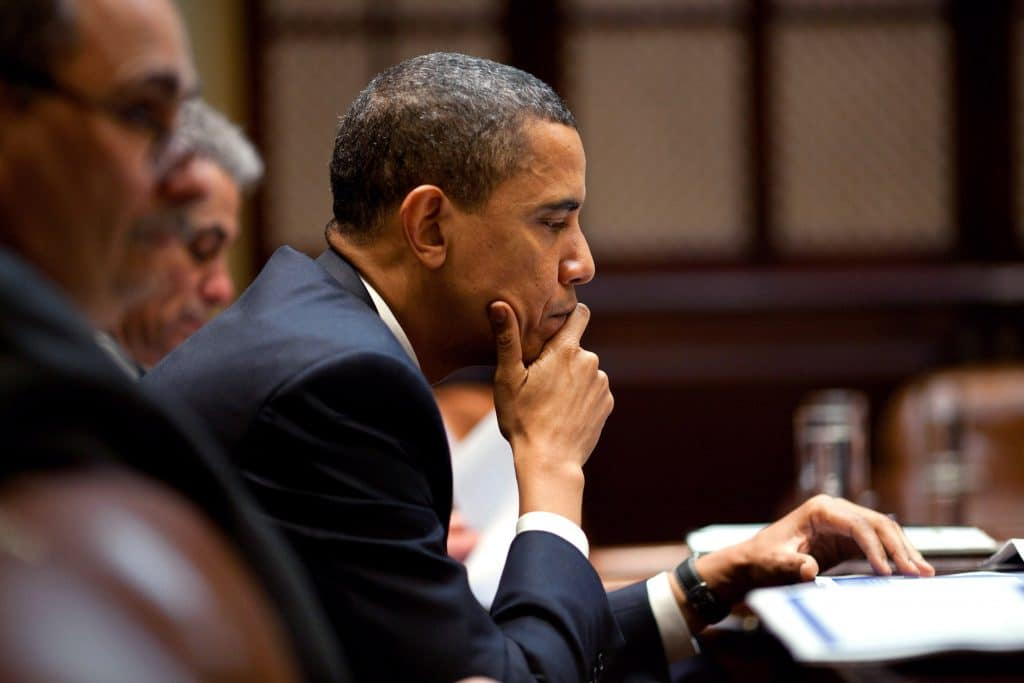 President Obama studies a document in the Roosevelt Room of the White House. (photo credit: The White House/Pete Souza)
