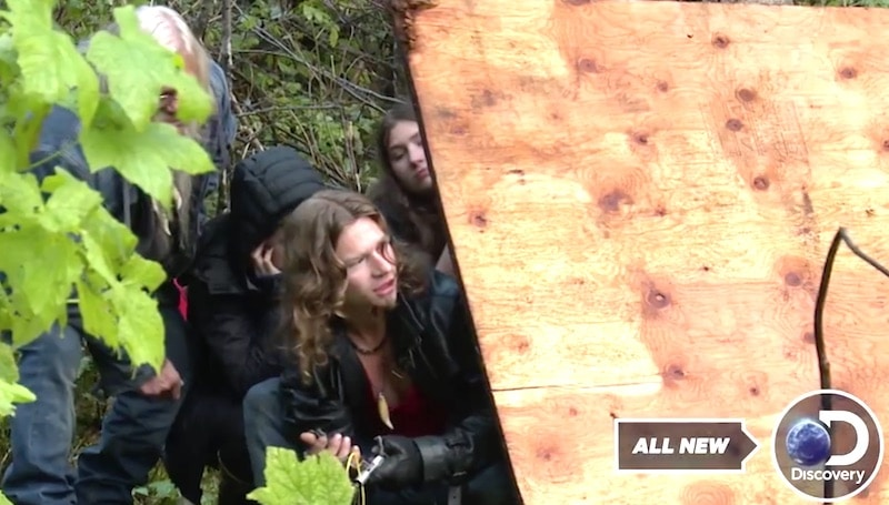 Bear flips the switch to blast the dynamite as the wolf pack hide behind plywood on Alaskan Bush People