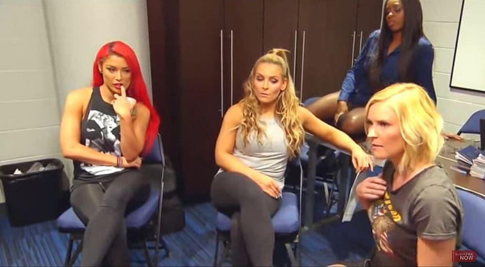 The Divas sitting around waiting