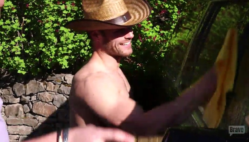 Mark flirts with male guest Skylar while washing a car topless on this week's Timber Creek Lodge