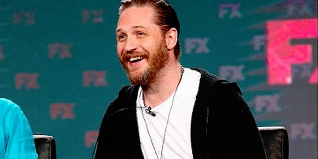 Tom Hardy speaking on stage at the TCA winter press tour