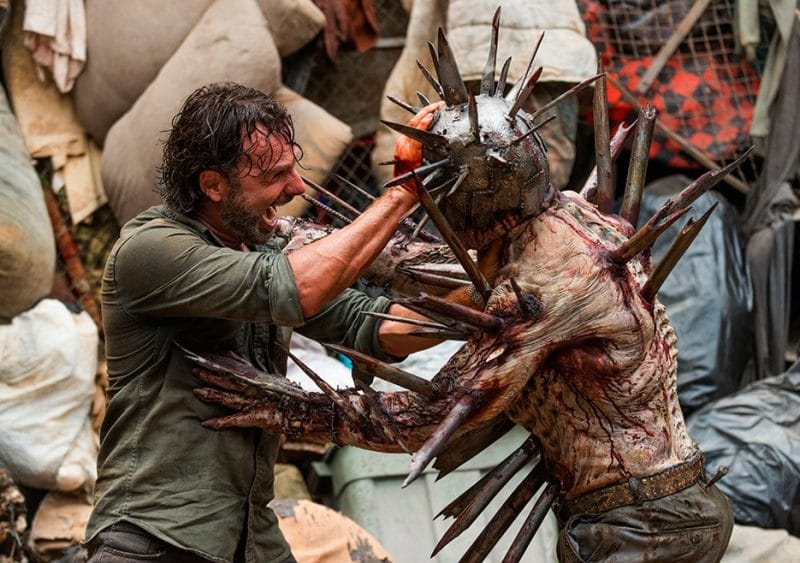 Rick battles a porcupine walker in the junkyard