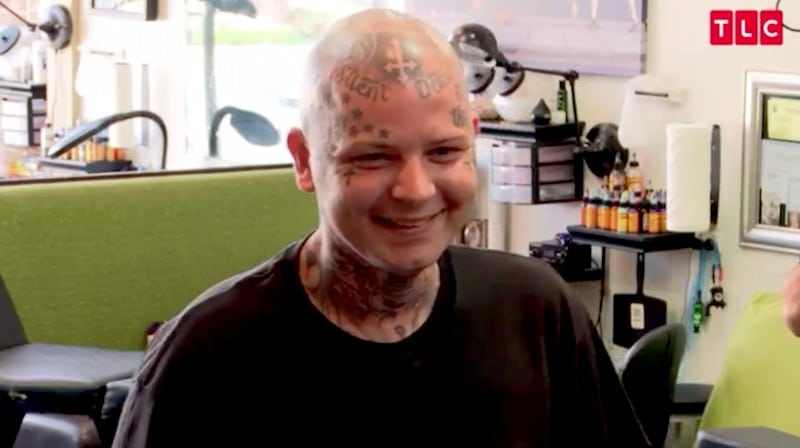 Brian seen from the front, with tattoos already covering much of his head