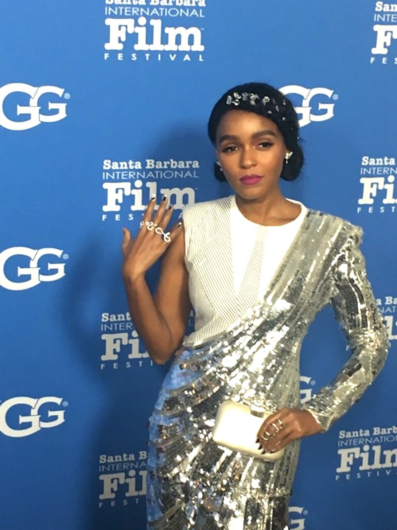 Janelle Monae does her best vamp in a sparkling gown evoking old school Hollywood glamour