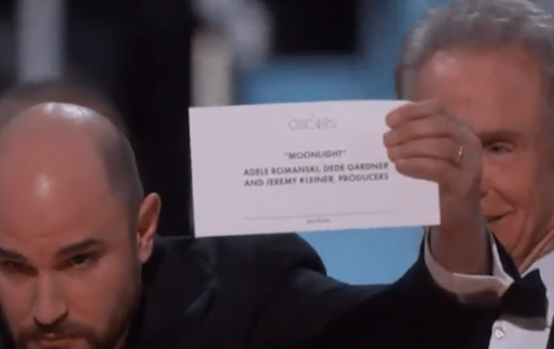 La La Land producer Jordan Horowitz holds up the correct winner's card