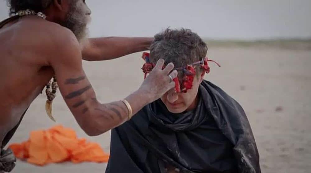 Reza Aslan has a headpiece put on his head by the Aghori cannibal guru