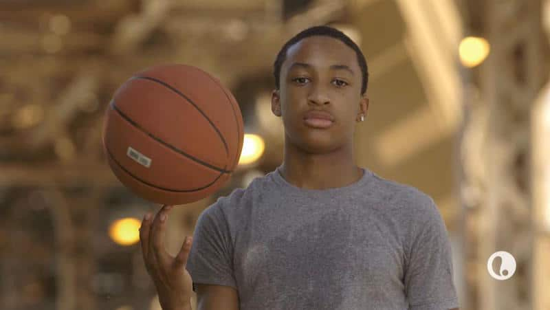 Talented Nimari, 14, spins a ball on his finger in footage from Bringing Up Ballers