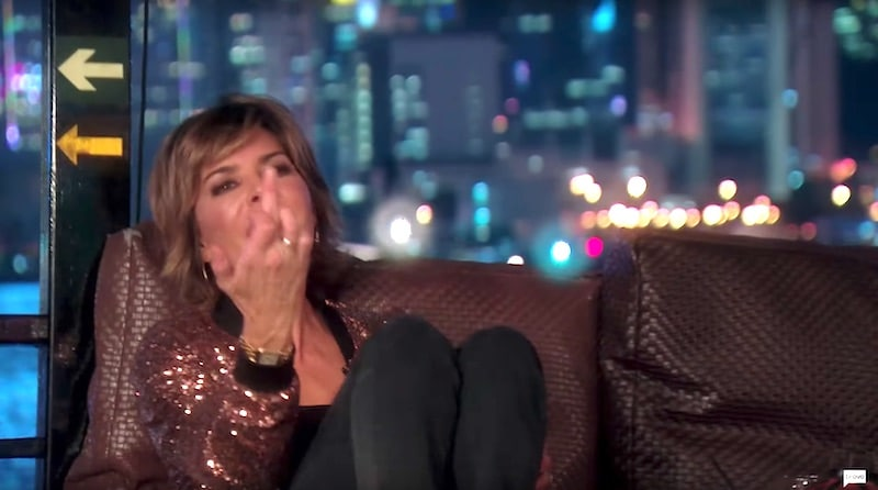 Lisa Rinna sticks her middle finger up at Dorit during the trip to Hong Kong