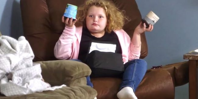 "Honey Boo Boo holds up Mama June's ice-cream stash with a look that says ""WTF?"""