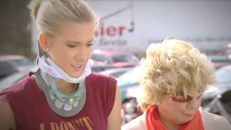Savannah, in a neck brace, and Todd's mother Faye, look at the wreckage of her car