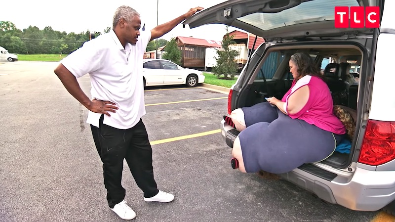 Anthony must stop the van periodically to tend to Tracey and help her stretch