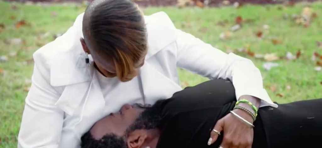 Iyanla comforts Soullow as he lies on the grass