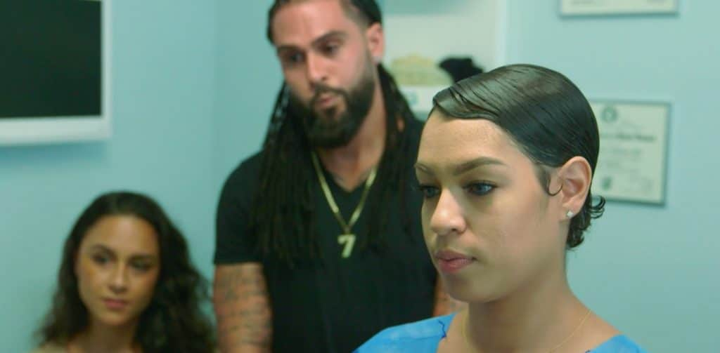 Dr. Miami is helping a woman with some breast reduction surgery