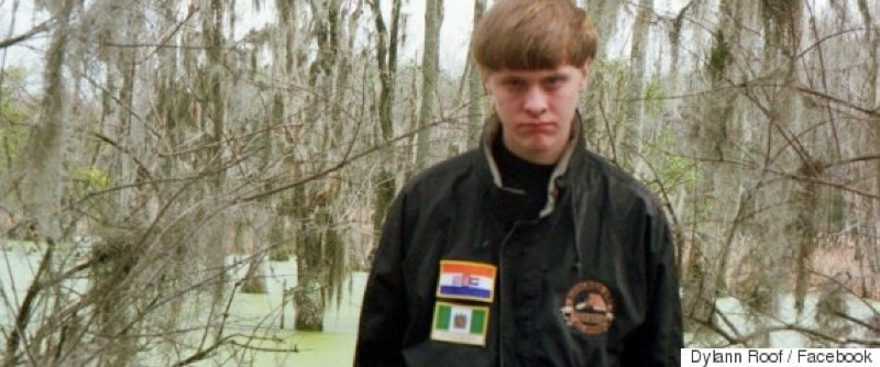 Dylann Roof wearing a jacket with some obscure white supremacy flags on it
