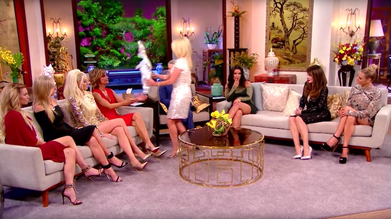 Kim walks over to Lisa to hand back the bunny she gave her for her grandson