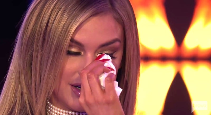 Lala wipes tears from her eyes after being taken aback by Katie's apology
