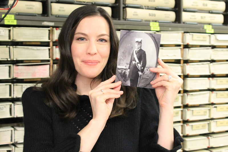Liv Tyler holds up a photo of her ancestor George Washington Elliott on Who Do You Think You Are?