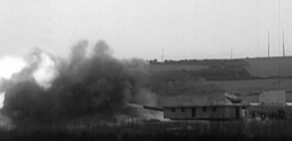 One of the large guns fires a shot