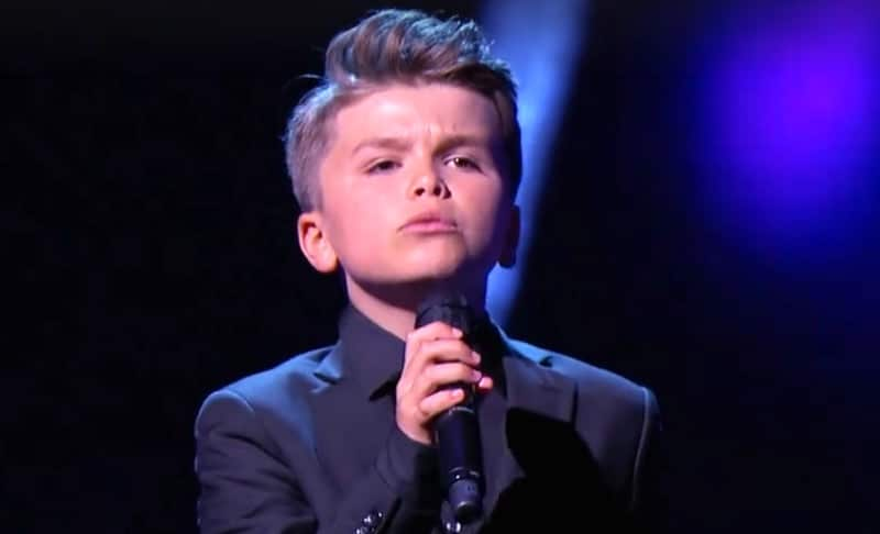 Reuben De Maid singing on stage during his appearance on Little Big Shots