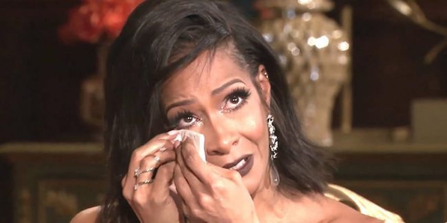 Sheree wipes tears from her eyes as she talks about her relationship with ex Bob on the RHOA reunion