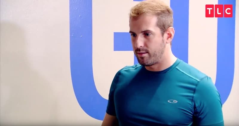 Todd's stunned face after Whitney tells him she's planning to join The Fitness Marshall on tour