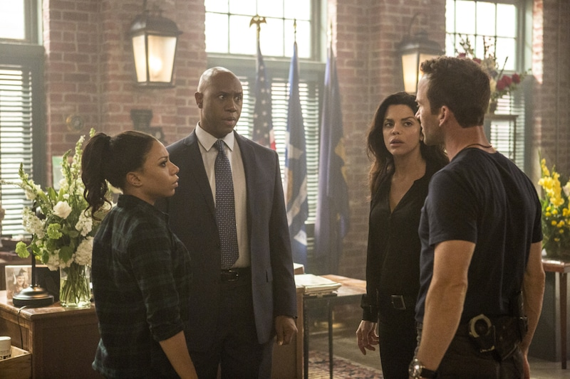 Derek Webster as FBI Assistant Director Isler, Shalita Grant as Sonja Percy, Vanessa Ferlito as FBI Special Agent Tammy Gregorio, and Lucas Black as Special Agent Christopher LaSalle, standing in a circle talking