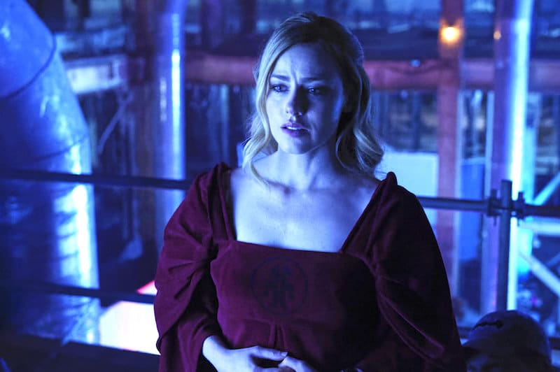 Amanda Schull looking worried in 12 Monkeys as Cassandra Railly, bathed in a blue light