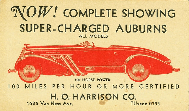 """An old advert featuring a sketch of a 1935 Auburn Speedster. It reads: """"Now! Complete showing super-charged Auburns"""""""