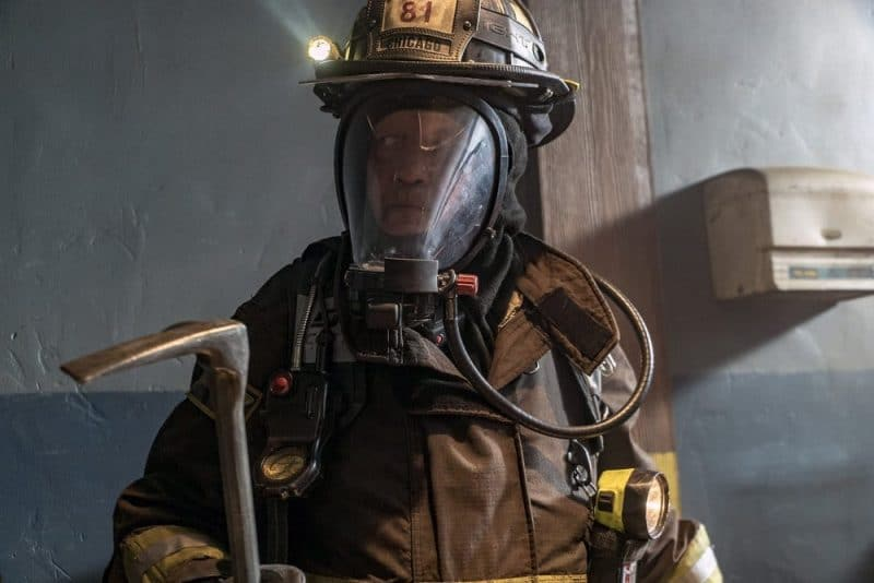 Christian Stolte as Mouch inside the burning building in his firefighting gear