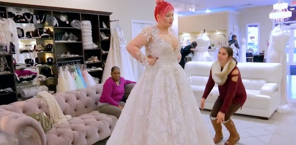 Amber looks stunning in the dress but she does not seem too happy