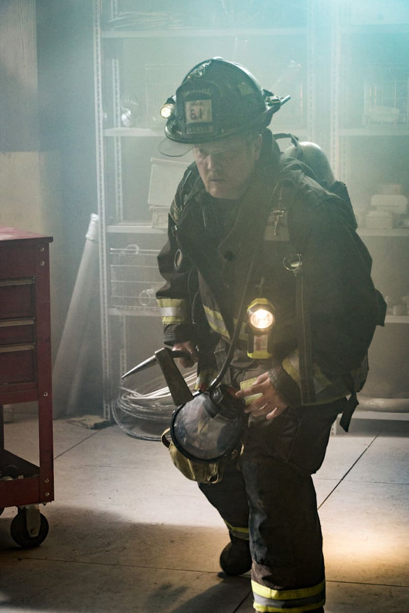 Randall McHolland in his fire-fighting gear inside a smokey room