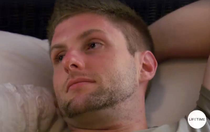 Close-up shot of Cody's head from Married at First Sight as he lies in bed staring into space