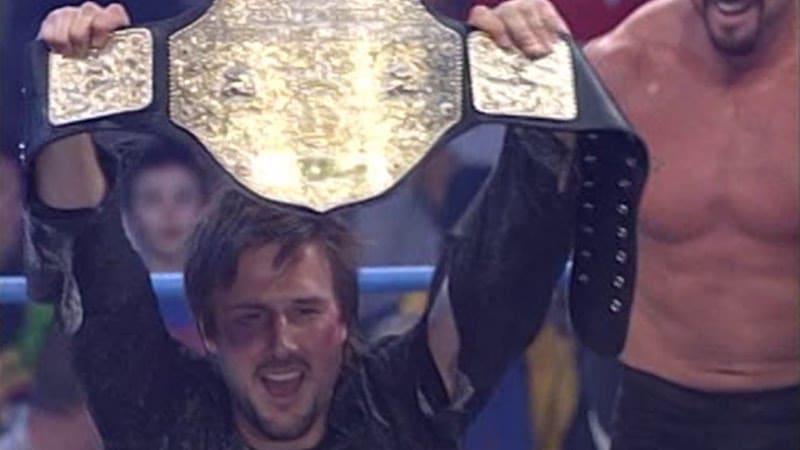 David Arquette lifting a wrestling belt