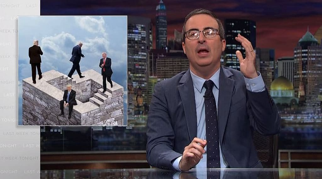 John Oliver on Last Week Tonight with a mock-up behind him of Trump on M.C. Escher-style steps