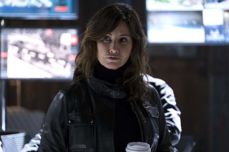 Gina Gershon's character smiles at someone off-screen in this week's Brooklyn Nine-Nine episode