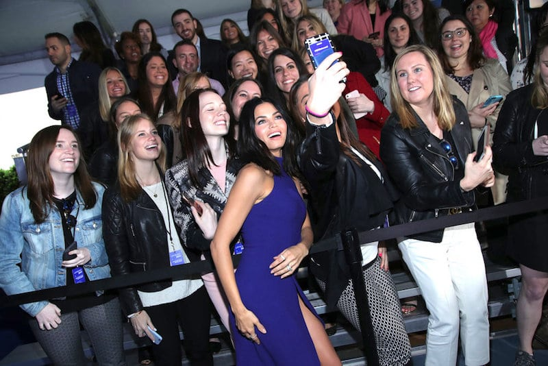 Jenna posing for a selfie with young female fans at an NBC event in New York City
