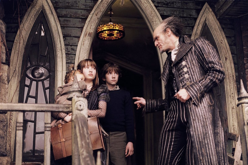 Emily and other cast in a still from Lemony Snicket's A Series of Unfortunate Events