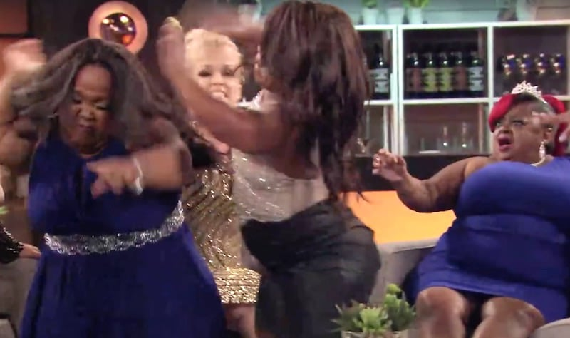Still of Minnie and Abira fighting on the Little Women: Atlanta reunion as Terra and Ms. Juicy look on