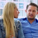 Anthony and Ashley sitting on a couch talking to the camera on Married at First Sight
