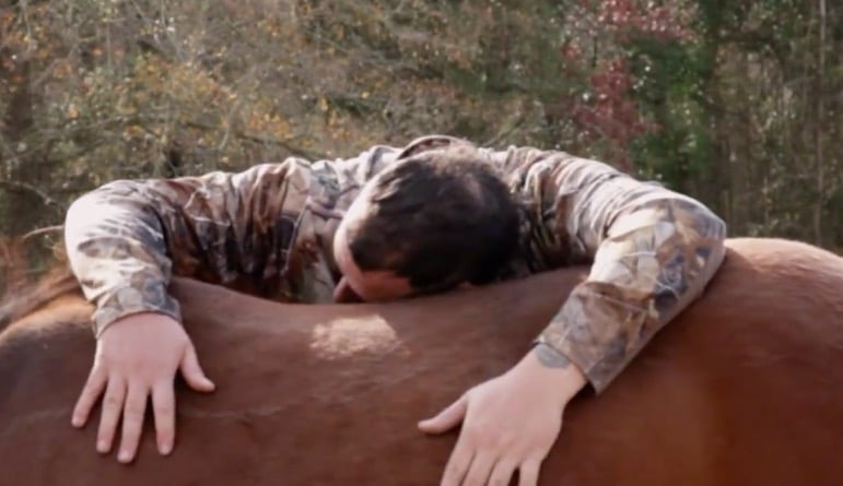 Hugging a horse on the farm