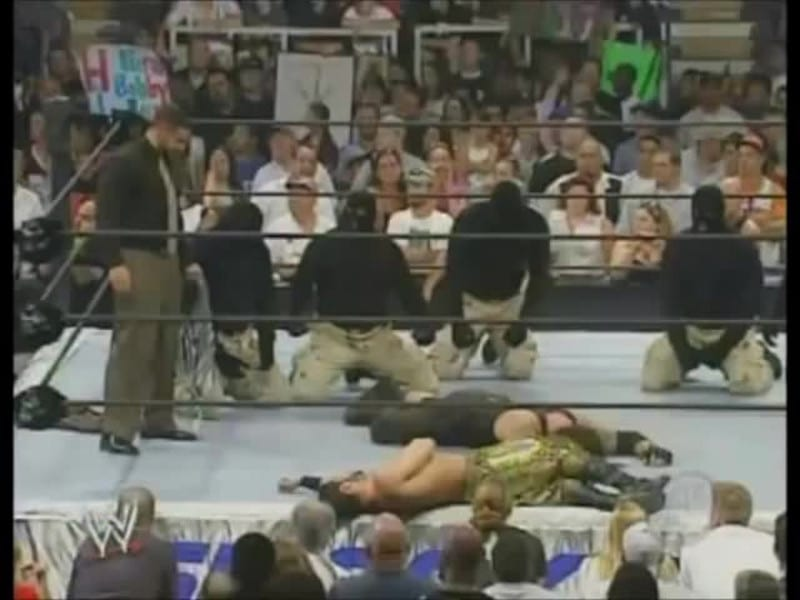 Muhammad Hassan and the masked men in the ring