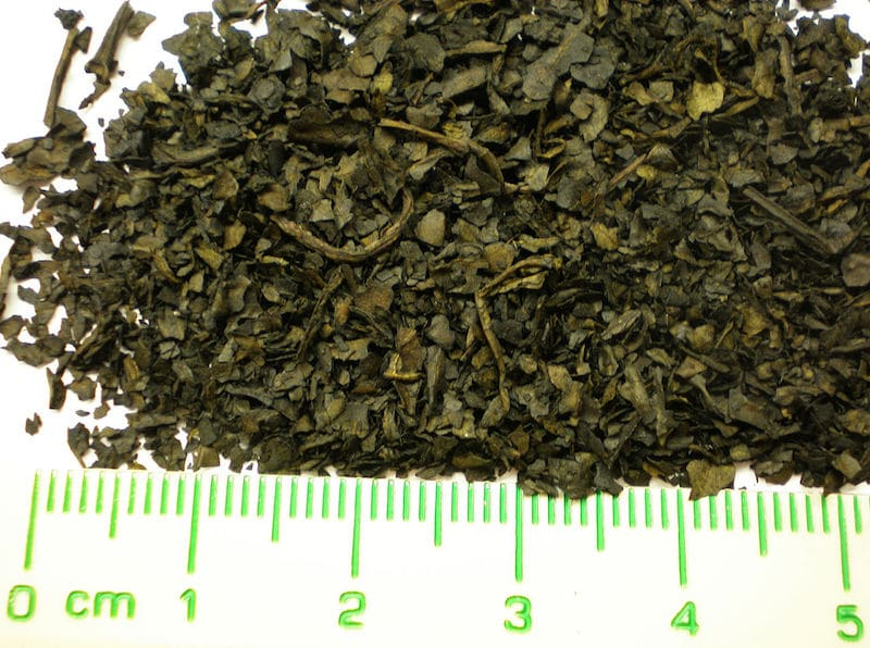 a pile of chopped prepared salvia with a ruler underneath