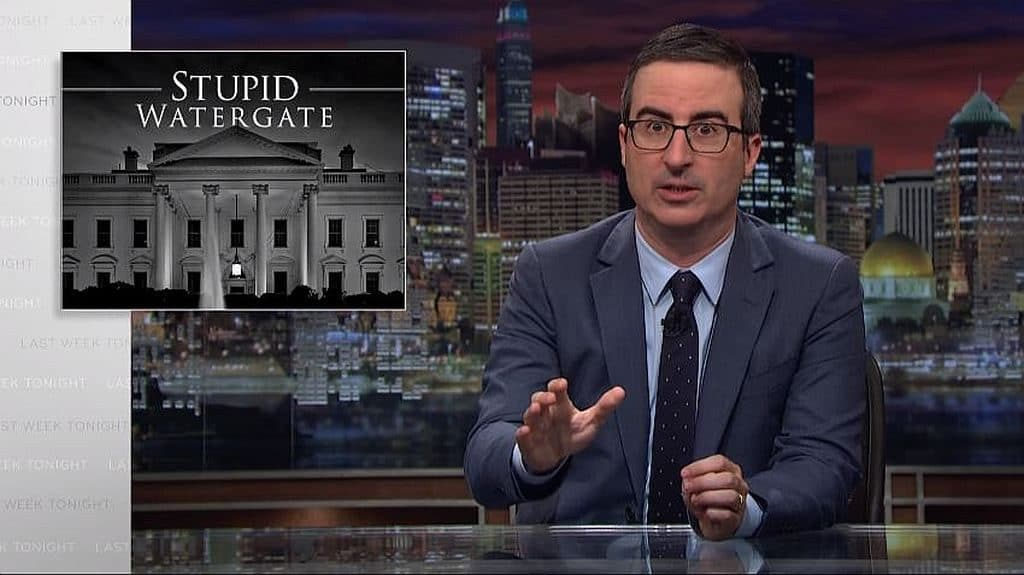 John Oliver discussing Donald Trump on Last Week Tonight. Picture behind him says 'Stupid Watergate'