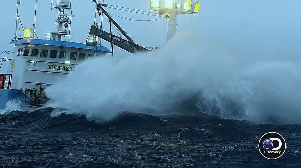 The Summer Bay hardly visible as a huge wave crashes on deck