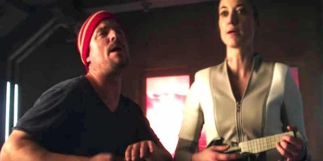 Android and Three singing while she gives him French lessons on Dark Matter