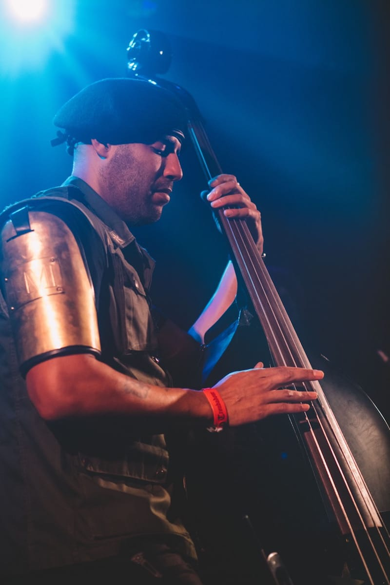 Miles Mosley playing the double bass