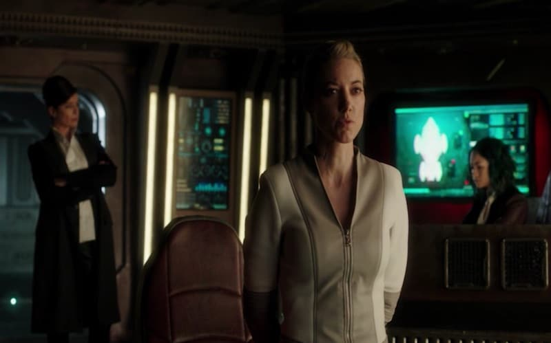 The Android talking with Commander Truffault and Five behind her in a scene from Dark Matter
