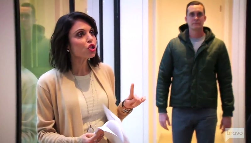 Bethenny Frankel talking as the developer walks up behind her on Million Dollar Listing New York