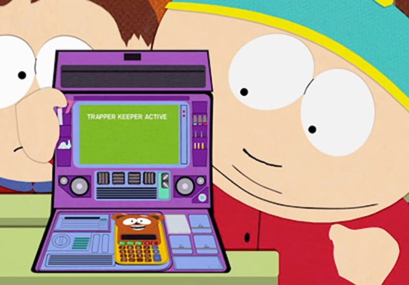 Cartman plays with his trapper keeper, which says 'TRAPPER KEEPER ACTIVE' on it