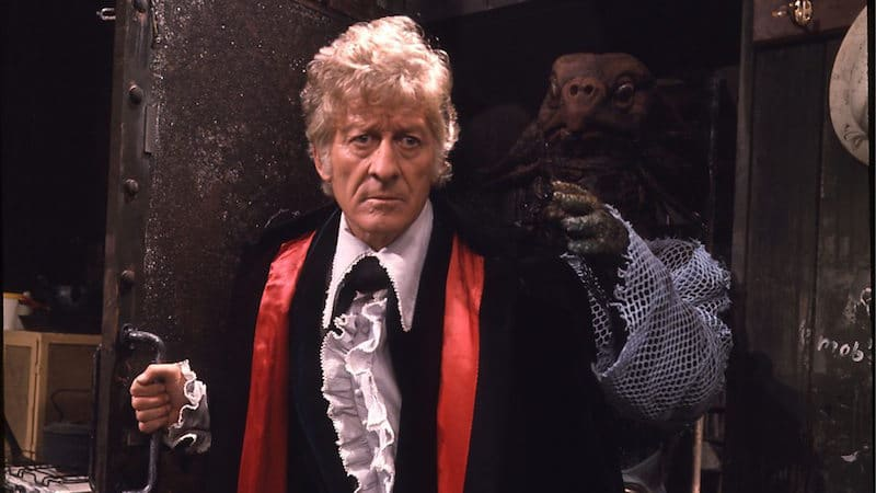 Jon Pertwee with a Sea Devil behind him in Doctor Who